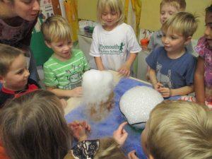 Children around science experiment